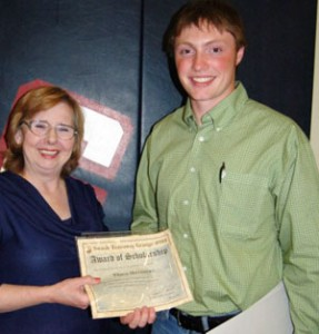 2009 Scholarship recipient Travis Matthews accepts award from Scholarship Chair Barb Sowers.