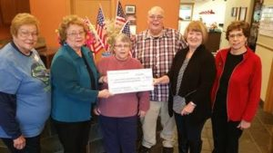 Donna Carollo and Barb Hamel (rt) present our $1,036.38   donation  to the Upper Kittitas County  Senior Center              Board for the Upper County Christmas Giving Fund